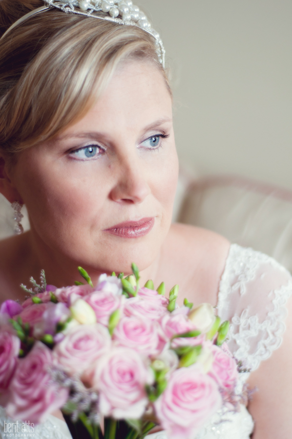 098_DSC_0166_bride_looking_out_of_window_portrait_wedding_photography_phoyographer_natural_light_flowers