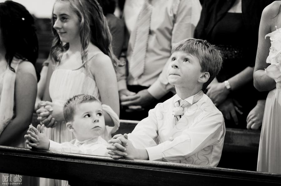 244-DSC_0216_wedding_photographer_pageboy_praying_at_the_church_clonmel