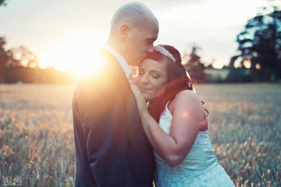 554-DSC_0256_bride_groom_photoshoot_natural_light_clonmel_posing_kiss_wedding_photography_photographer_sun_evening_sunset_backlight