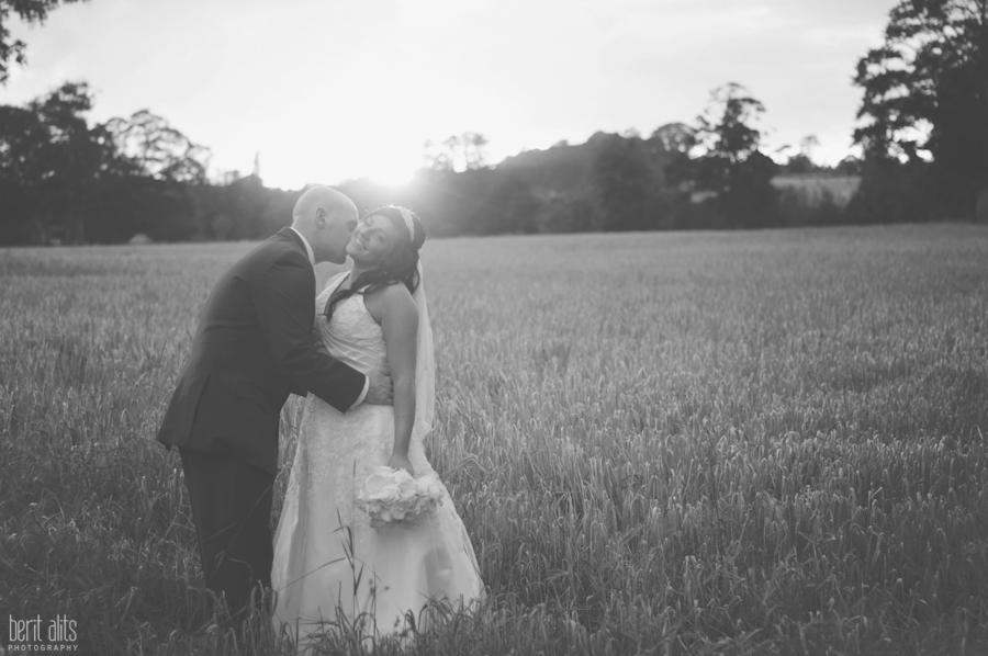 570-DSC_0321bw_bride_groom_photoshoot_natural_light_clonmel_posing_kiss_wedding_photography_photographer_sun_evening_sunset_backlight