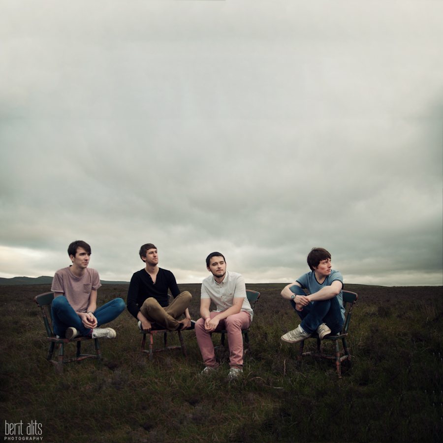 responsible_looking_freaks_portrait_photography_empty_field_chairs_band_posing_moody_sky_natural_light_group