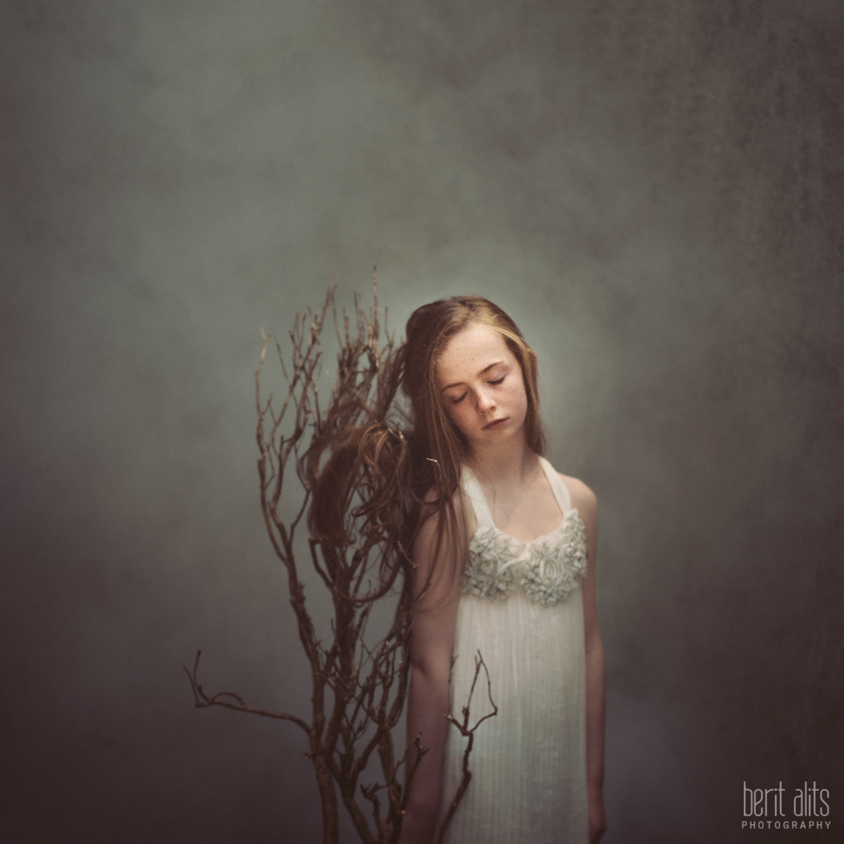 05_Standing_With_The_Wind_creative_portrait_artistic_young_girl_clonmel_tipperary_ireland_photography_photographer_family_different_windy_long_hair_dreamy_nikon_d800_50mm_f1.4_square_format_natural_light_pose_posing_smoke