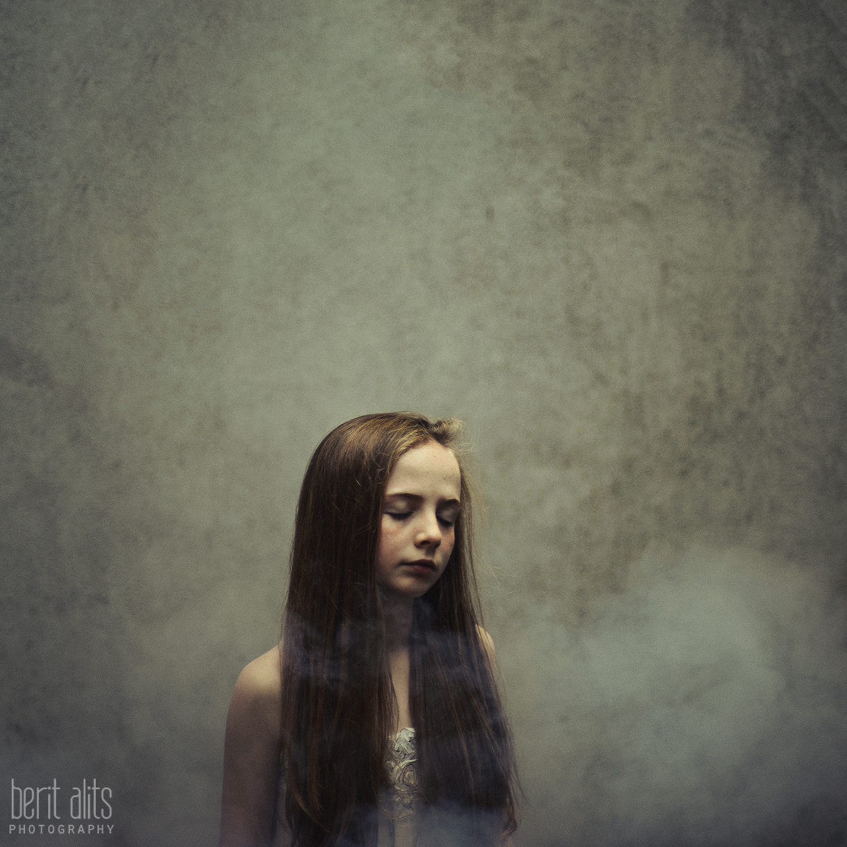 06_Standing_With_The_Wind_creative_portrait_artistic_young_girl_clonmel_tipperary_ireland_photography_photographer_family_different_windy_long_hair_dreamy_nikon_d800_50mm_f1.4_square_format_natural_light_pose_posing_smoke