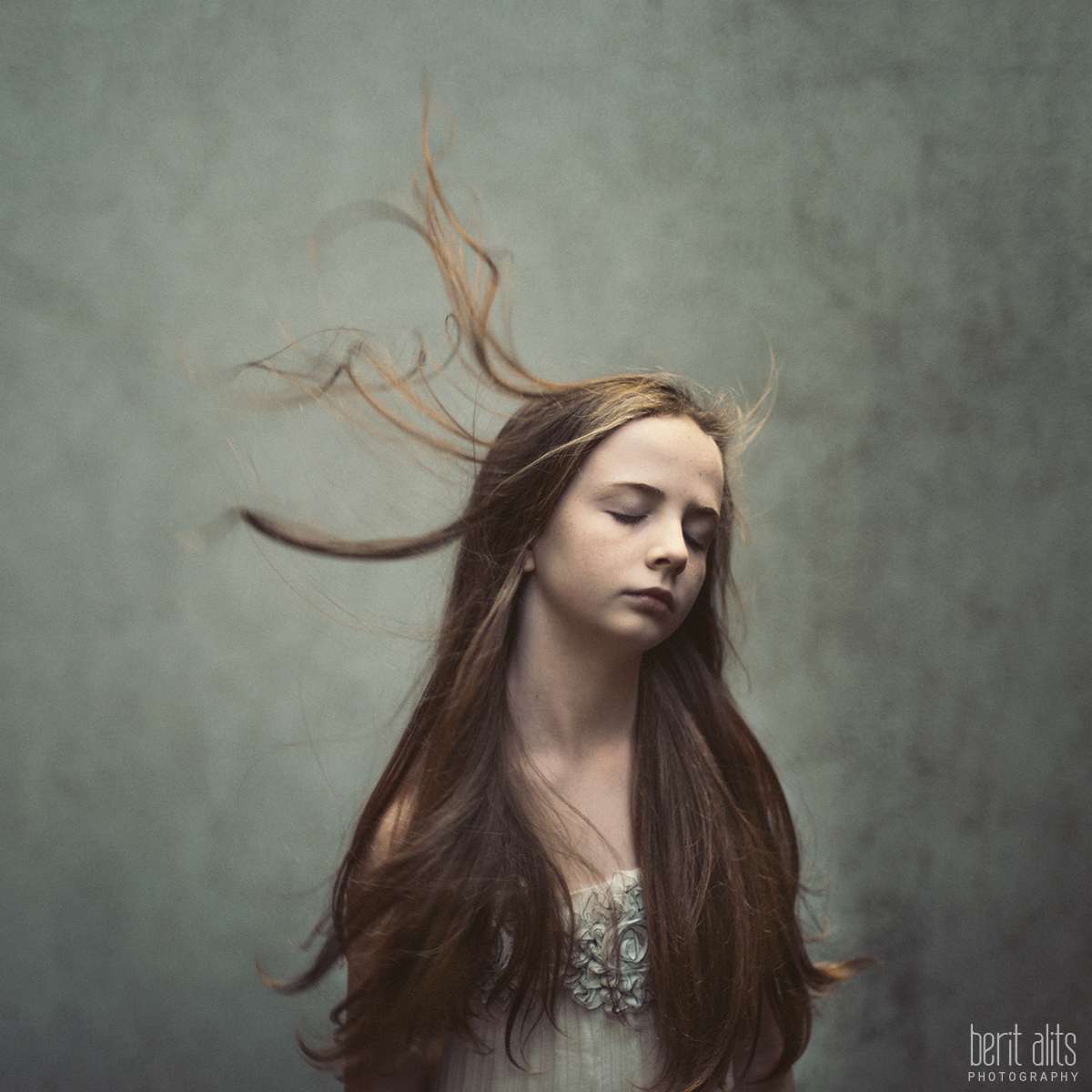 01_Standing_With_The_Wind_creative_portrait_artistic_young_girl_clonmel_tipperary_ireland_photography_photographer_family_different_windy_long_hair_dreamy_nikon_d800_50mm_f1.4_square_format_natural_light_pose_posing