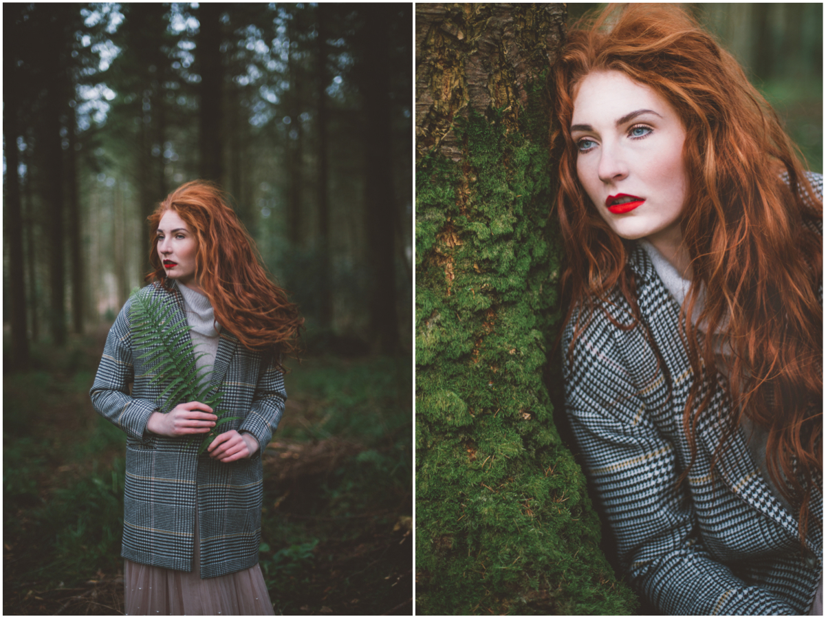 02 redhead girl standing in green forest holding a fern, portrait photography